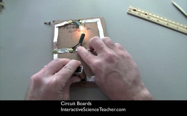 Simple circuit boards-built out of cardboard, foil, and christmas tree lights